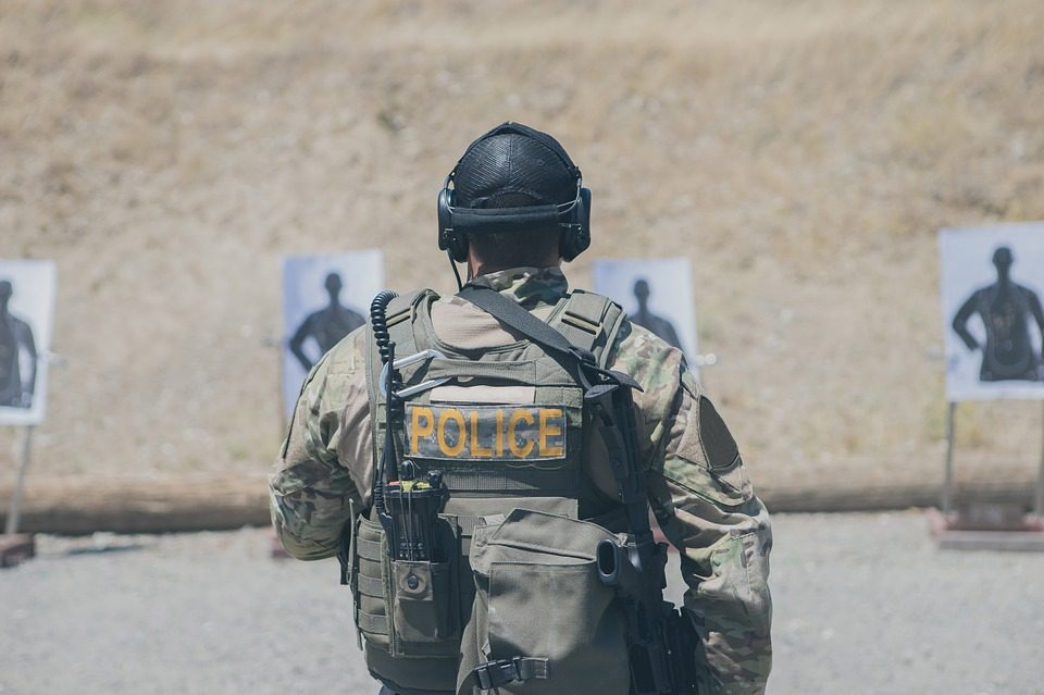 Tactical policeman in full gear at tactical firing range